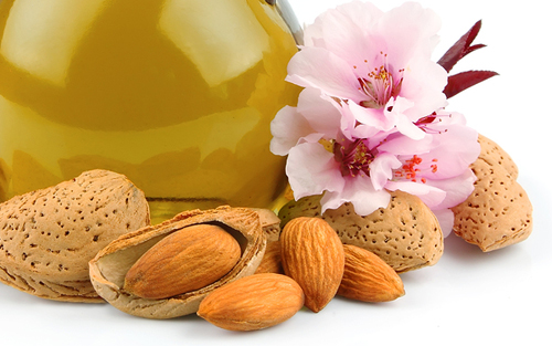 Almonds Fresh and Roasted with Almond Oil and Almond Blossoms