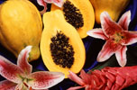 Whole and Half Papayas With Flowers